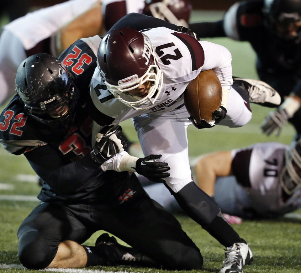 Westmoore's Chase Silva (32) brings down Jenks' Tye Brett in high school football on Friday, Oct. 18, 2013 in Moore, Okla.  Jenks retained possession.  Photo by Steve Sisney, The Oklahoman