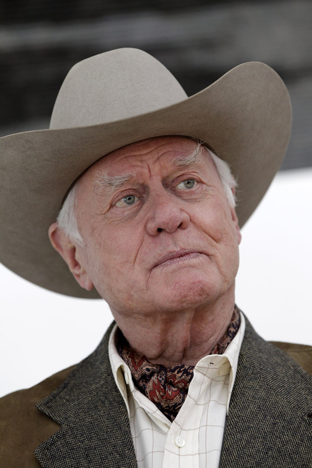 Photo -   FILE - In this Nov. 4, 2011 file photo, actor Larry Hagman pauses during an interview on location during the filming for the upcoming new television show