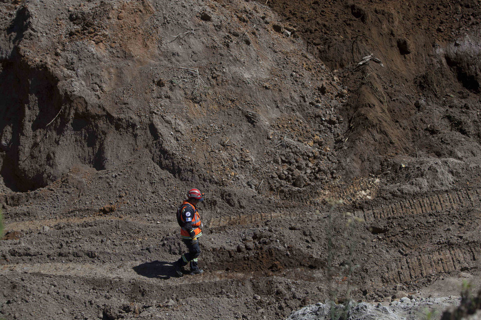 Photo - A rescue worker walks in a sand mine where people are feared to be buried after an earthquake in San Marcos, Guatemala, Thursday, Nov. 8, 2012. A magnitude 7.4 earthquake struck on Wednesday, killing at least 52 people and leaving dozens more missing. (AP Photo/Moises Castillo) ORG XMIT: GUA116