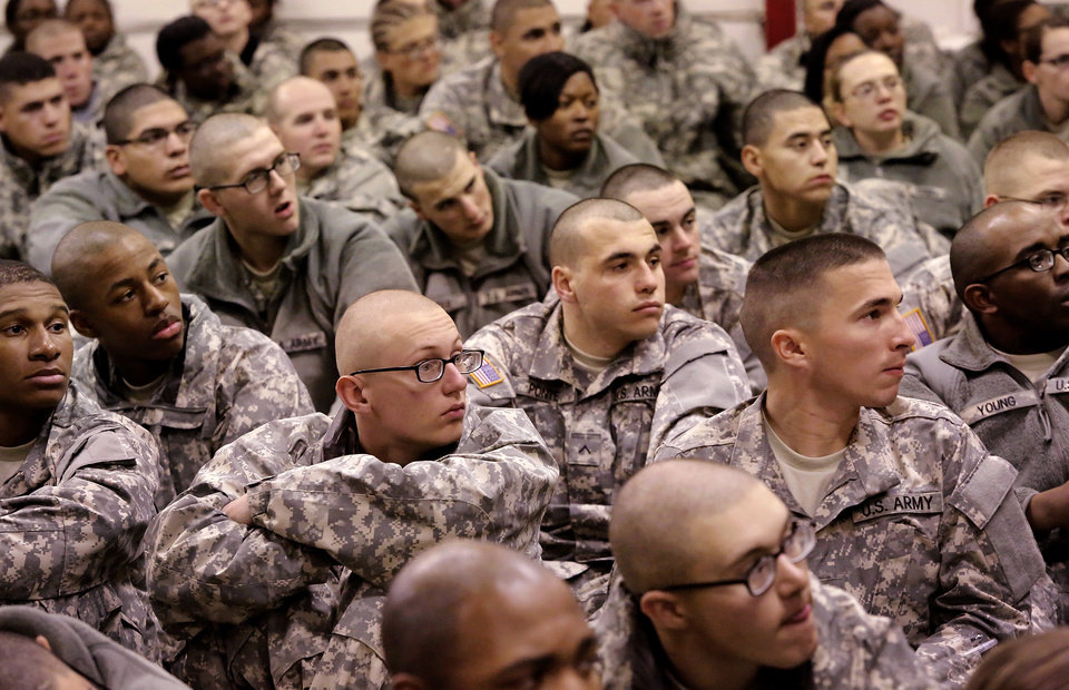 Soldiers sit on the floor in a large room adjacent to the Military Welcome Center to hear instructions from their drill sergeants before they are escorted to the boarding gates. Nearly 700 soldiers from Ft. Sill, most of whom had recently completed their basic training,  arrived at Will Rogers World Airport on buses in pre-dawn hours Thursday,  Dec. 20, 2012, to catch flights to join join their families for the Christmas holidays.  The troops were welcomed by Blue Star Mothers and other volunteers at the YMCA Military Welcome Center, where they were offered pizzas, doughnuts,  chips, sub sandwiches, desserts, hot coffee and cold beverages. Local merchants donated 250 pizzas, 60 dozen doughnuts and the submarine sandwiches.   Photo by Jim Beckel, The Oklahoman