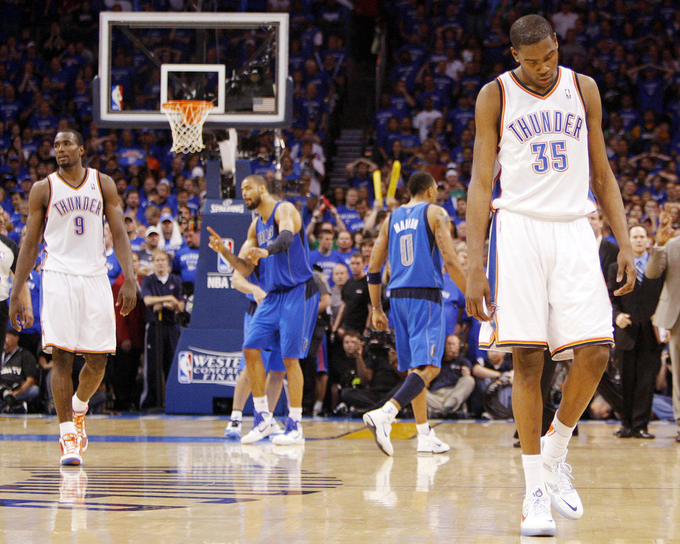 Oklahoma City's Kevin Durant (35) and Serge Ibaka (9) walk back to defend the final 0.7 seconds of regulation after Durant had a three-point shot blocked in the fourth quarter during game 4 of the Western Conference Finals in the NBA basketball playoffs between the Dallas Mavericks and the Oklahoma City Thunder at the Oklahoma City Arena in downtown Oklahoma City, Monday, May 23, 2011. Dallas won in overtime, 112-105. Photo by Nate Billings, The Oklahoman