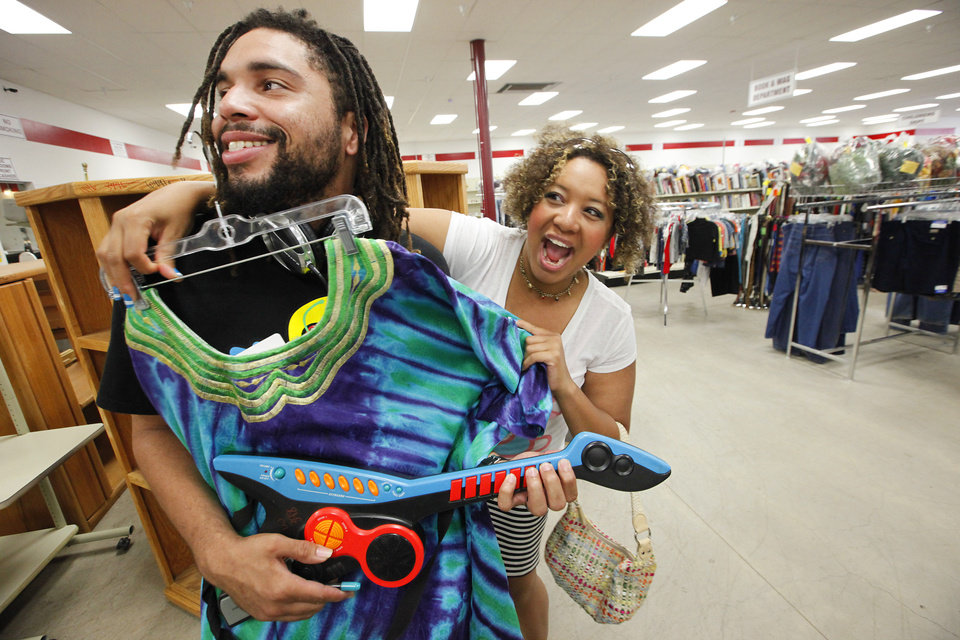 Photo - Siblings Brandy and Boe Clark shop at a thrift store. Brandy Clark has been through some hard times on her path to recovery with mental illness, and Boe Clark has stood by her to offer support. Photo by David McDaniel, The Oklahoman  David McDaniel