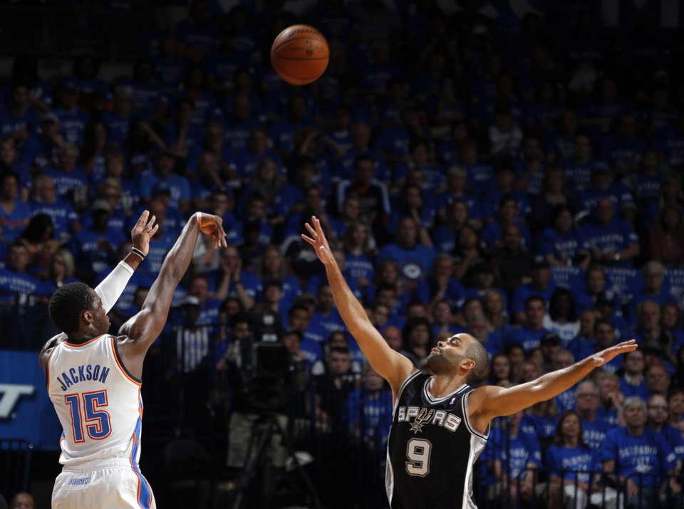 Photo - Oklahoma City's Reggie Jackson (15) shoots over San Antonio's Tony Parker (9) during Game 3 of the Western Conference Finals in the NBA playoffs between the Oklahoma City Thunder and the San Antonio Spurs at Chesapeake Energy Arena in Oklahoma City, Sunday, May 25, 2014. Photo by Bryan Terry, The Oklahoman