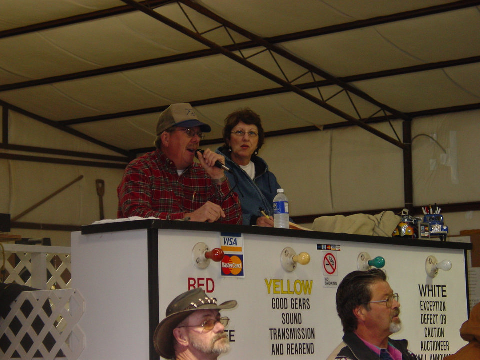 Carl Harryman and his wife Donna on the podium at the aution house Community Photo By: Dave Baughn Submitted By: David,