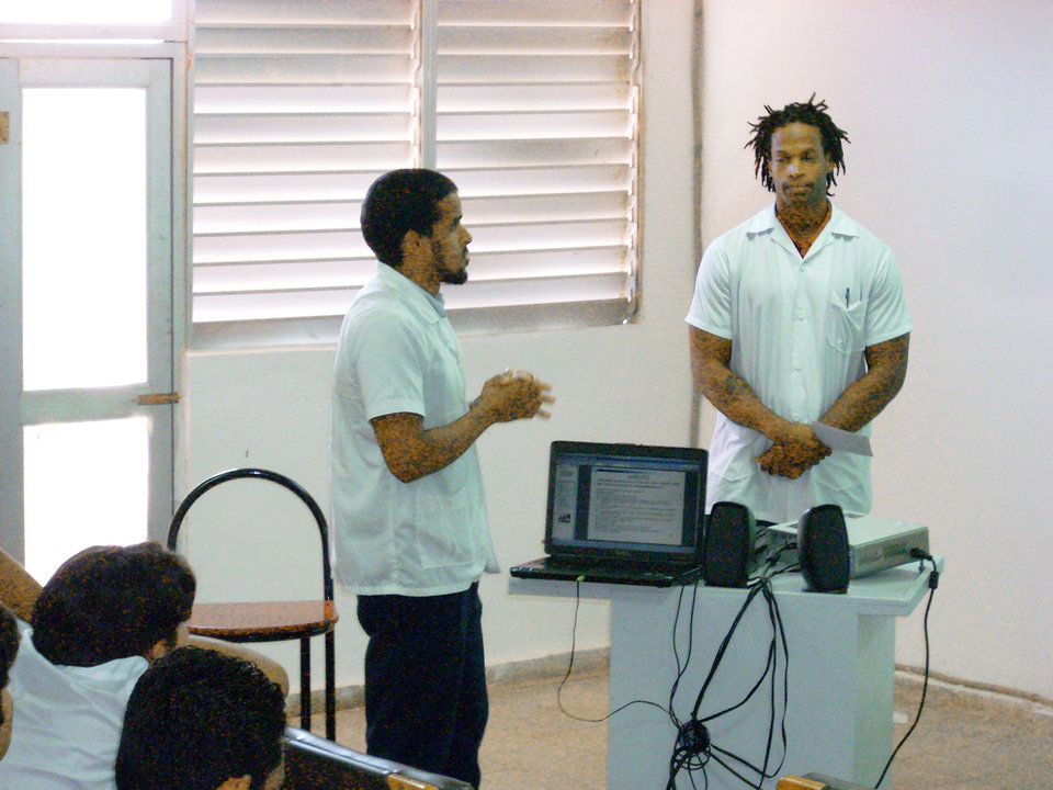 Former OU linebacker Pasha Jackson, right, gave up the dream of playing in the NFL to study medicine at the Latin American School of Medicine in Havana, Cuba. Photo Provided
