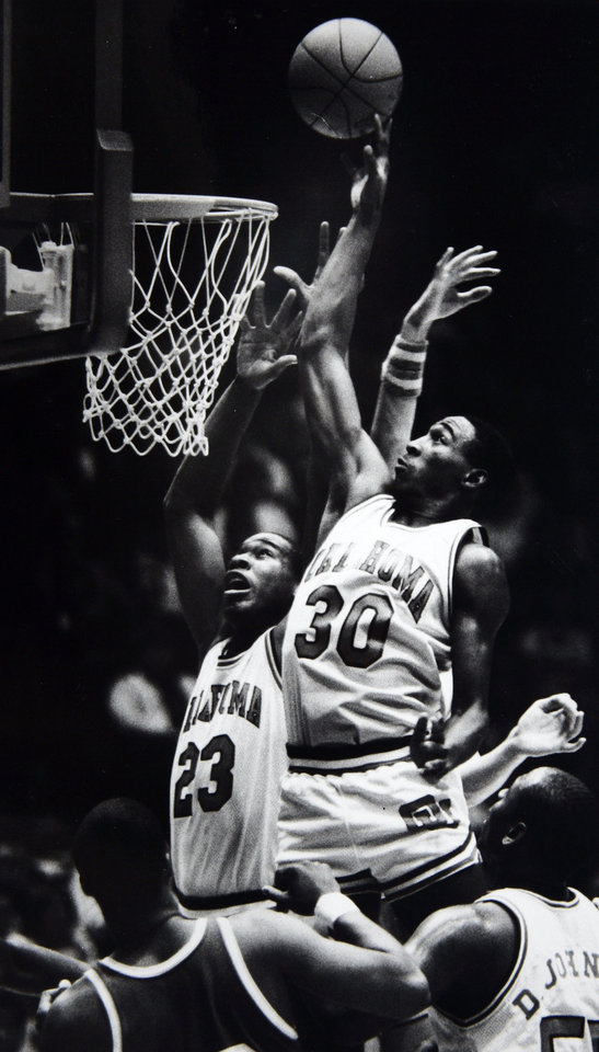 Photo - Former OU basketball player Wayman Tisdale. Darryl Kennedy (30), who had a career-high 24 points, and Wayman Tisdale have control of the offensive boards for OU on this play. Staff photo by Paul S. Howell. Photo taken 2/18/1984, Photo published 2/19/1984 in The Daily Oklahoman. ORG XMIT: KOD