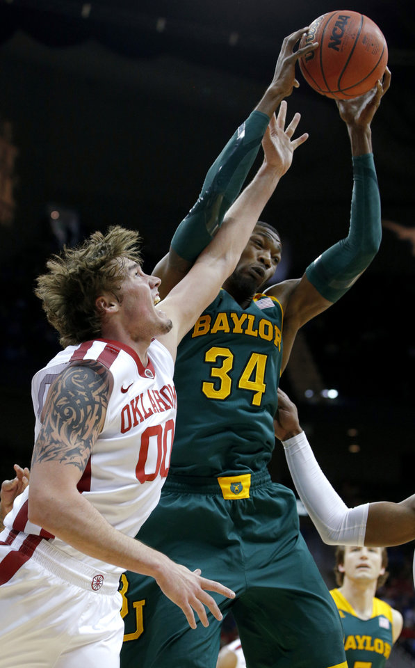 Photo - Baylor's Cory Jefferson (34) grabs a rebound over Oklahoma's Ryan Spangler (00) during the Big 12 Tournament college basketball game between the University of Oklahoma and Baylor at the Sprint Center in Kansas City, Mo., Thursday, March 13, 2014. Photo by Bryan Terry, The Oklahoman