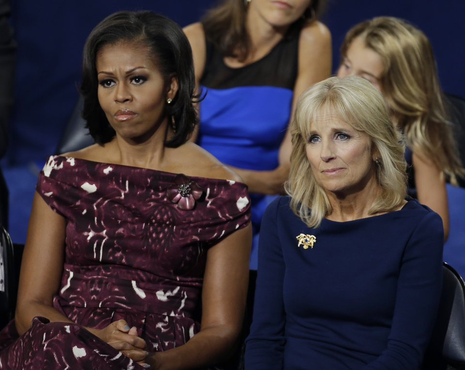 Photo -   First lady Michelle Obama, left and Dr. Jill Biden, wife of Vice President Biden, listen to Vice President Joe Biden at the Democratic National Convention in Charlotte, N.C., on Thursday, Sept. 6, 2012. (AP Photo/Charlie Neibergall)