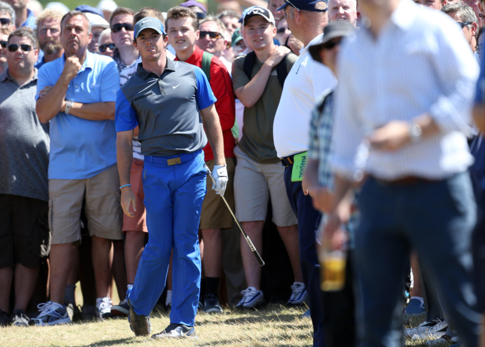 Photo - Rory McIlroy of Northern Ireland plays a shot on the 16th hole during the first day of the British Open Golf championship at the Royal Liverpool golf club, Hoylake, England, Thursday July 17, 2014. (AP Photo/Peter Morrison)