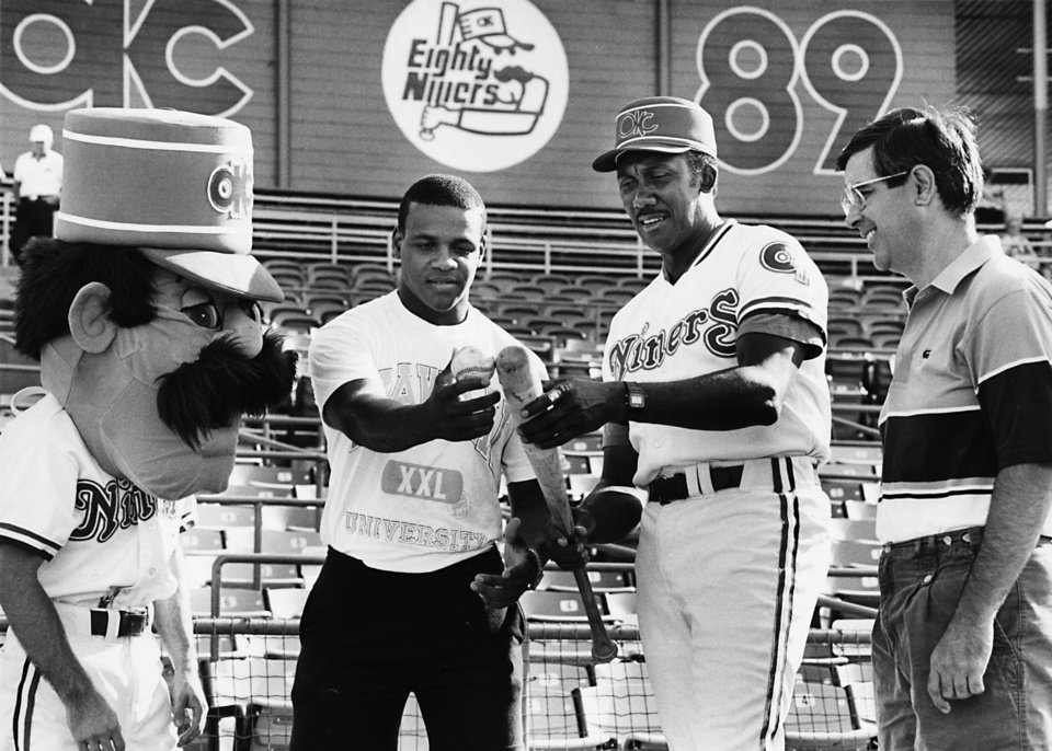 Photo - Abner 89er, Sam Burfict, Ferguson (Fergie) Jenkins and Stanley Hupfeld, from left, admire a bat and ball used by the Oklahoma City 89ers. Ferguson Jenkins is a former major league baseball player (Chicago Cubs) and was the Oklahoma City 89ers pitching coach in 1989. Jenkins was inducted into the Oklahoma Sports Hall of Fame on March 20, 2012. Staff photo by Jim Beckel, 8-6-89.