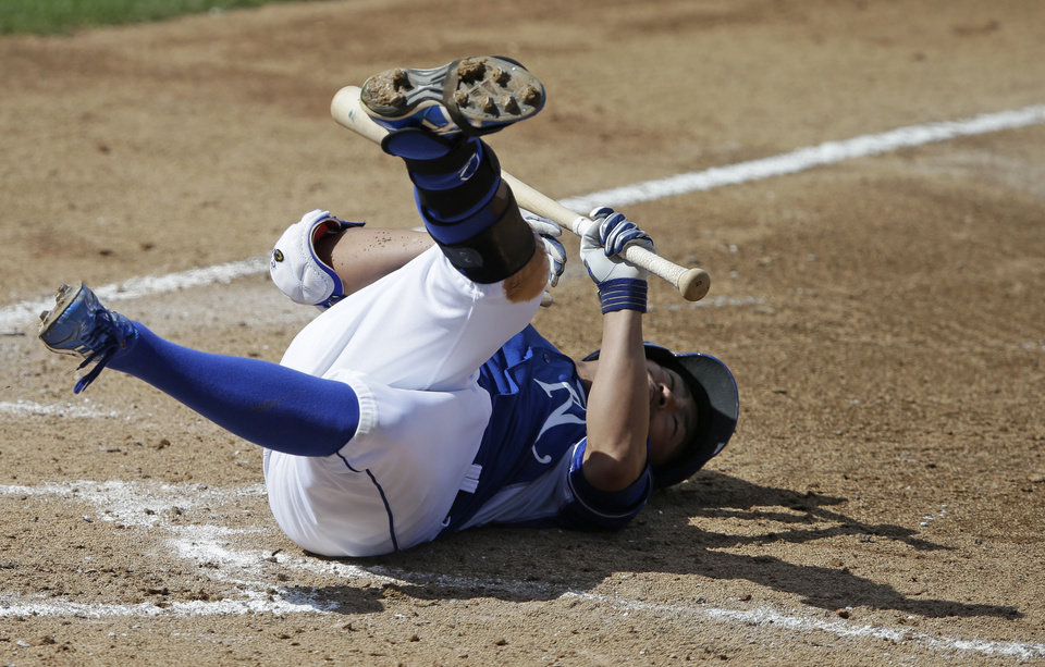 Photo - Kansas City Royals' Norichika Aoki falls to the ground after being hit by a pitch during the fifth inning of a spring exhibition baseball game against the Los Angeles Dodgers Tuesday, March 11, 2014, in Surprise, Ariz. (AP Photo/Darron Cummings)