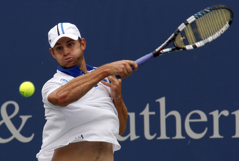 Photo -  Andy Roddick, of the United States, returns a shot to Jeremy Chardy, of France, during a match at the Western & Southern Open tennis tournament, Tuesday Aug. 14, 2012, in Mason, Ohio. (AP Photo/Tom Uhlman)