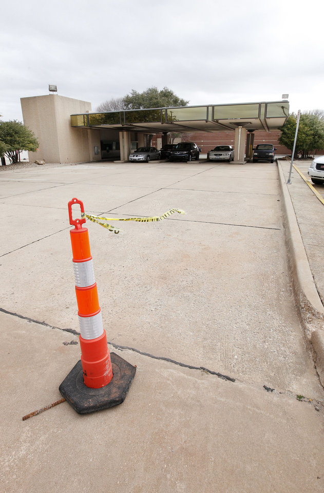 Signs of the start of demolition can be seen at the old Chase Bank drive-thru, at Littler Avenue and Second Street, to make room for the new public safety center in downtown Edmond. PHOTO BY PAUL B. SOUTHERLAND, THE OKLAHOMAN. <strong>PAUL B. SOUTHERLAND - THE OKLAHOMAN</strong>