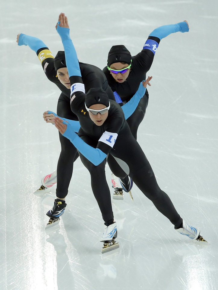 Photo - Speedskaters from the U.S. Brittany Bowe, Heather Richardson, and Jilleanne Rookard, front to rear, compete in the women's speedskating team pursuit quarterfinals at the Adler Arena Skating Center during the 2014 Winter Olympics in Sochi, Russia, Friday, Feb. 21, 2014. (AP Photo/Patrick Semansky)