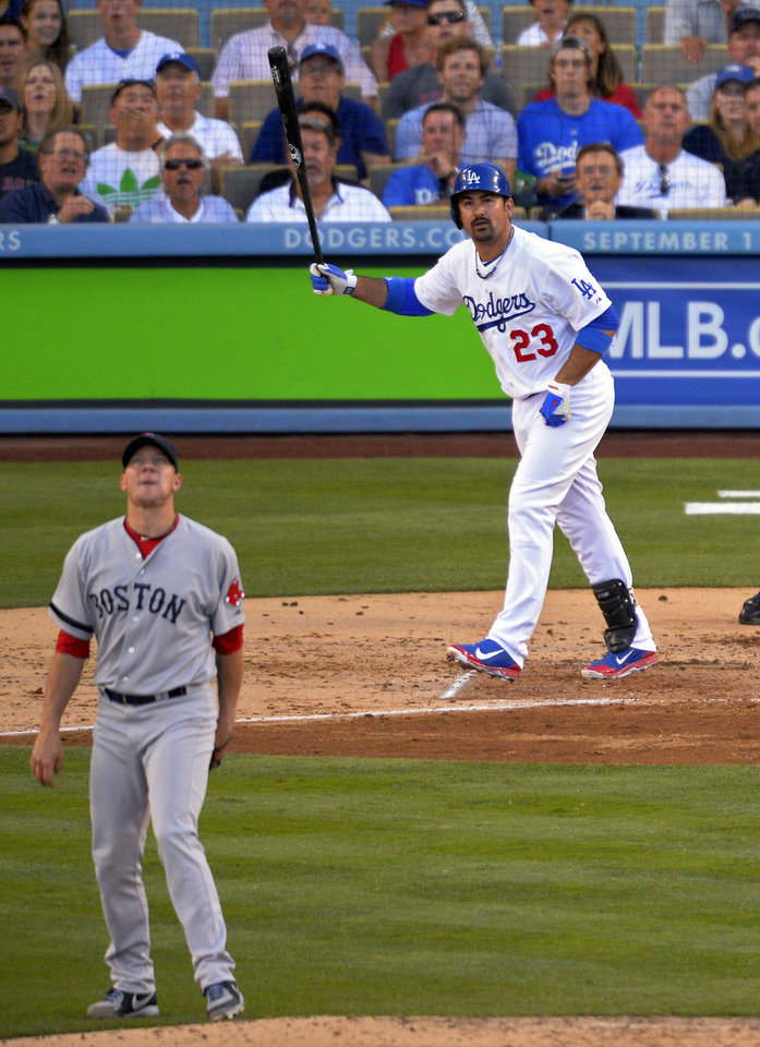 Photo - Los Angeles Dodgers' Adrian Gonzalez, right, watches his ball go out for a solo home run as Boston Red Sox starting pitcher Jake Peavy looks on during the fourth inning of their baseball game, Sunday, Aug. 25, 2013, in Los Angeles.  (AP Photo/Mark J. Terrill)