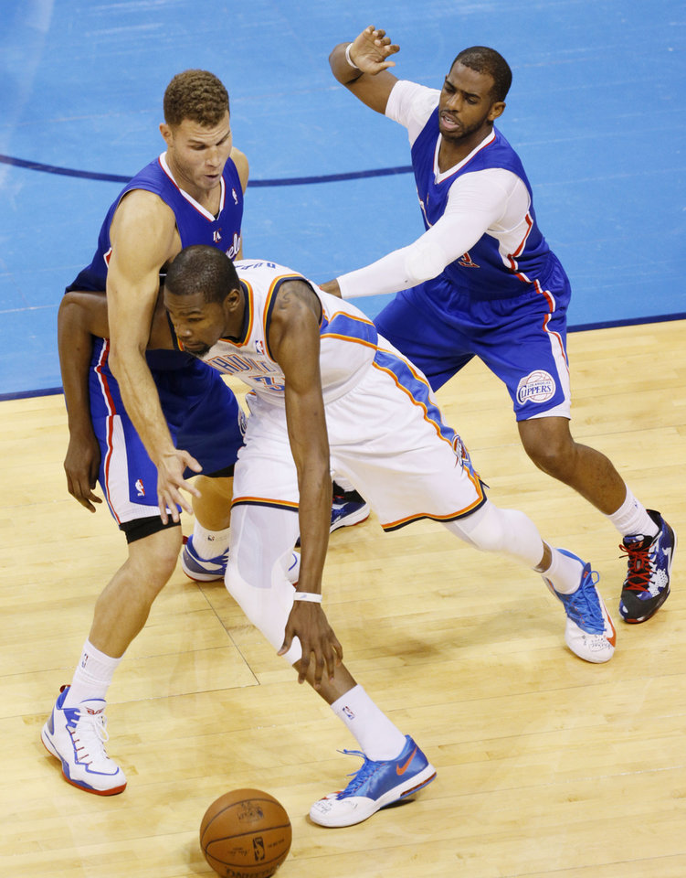 Photo - Blake Griffin (32) and Chris Paul (3) defend against Kevin Durant (35) during Game 5 of the Western Conference semifinals in the NBA playoffs between the Oklahoma City Thunder and the Los Angeles Clippers at Chesapeake Energy Arena in Oklahoma City,  Tuesday, May 13, 2014. Photo by Bryan Terry, The Oklahoman