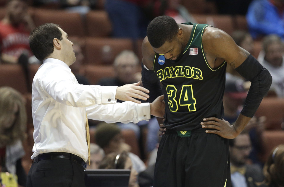 Photo - Baylor coach Scott Drew talks with Cory Jefferson during the second half against Wisconsin in an NCAA men's college basketball tournament regional semifinal, Thursday, March 27, 2014, in Anaheim, Calif. Wisconsin won 69-52. (AP Photo/Jae C. Hong)