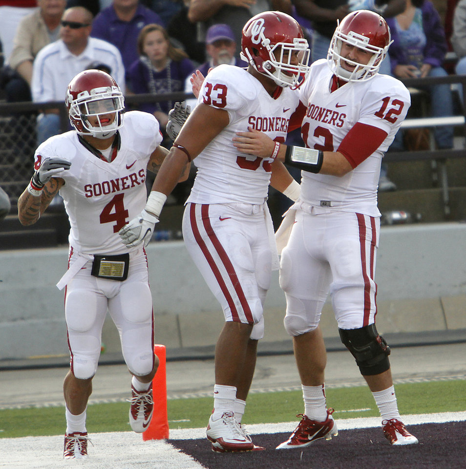 Oklahoma Sooners\' Trey Millard (33) celebrates with Kenny Stills (4) and Landry Jones (12) after a touchdown during the college football game between the University of Oklahoma Sooners (OU) and the Kansas State University Wildcats (KSU) at Bill Snyder Family Stadium on Sunday, Oct. 30, 2011. in Manhattan, Kan. Photo by Chris Landsberger, The Oklahoman ORG XMIT: KOD