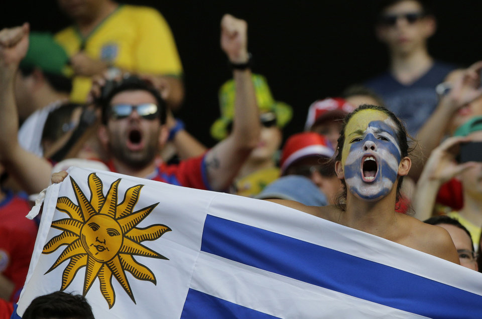 Photo - A Uruguayan supporter cheers before the group D World Cup soccer match between Uruguay and Costa Rica at the Arena Castelao in Fortaleza, Brazil, Saturday, June 14, 2014. (AP Photo/Christophe Ena)