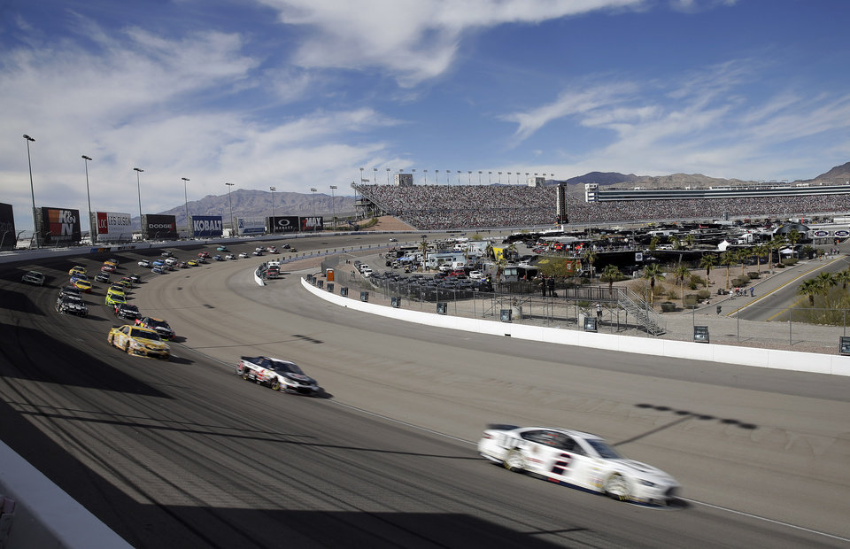 Photo - Brad Keselowski (2) drives during a restart at a NASCAR Sprint Cup Series auto race Sunday, March 9, 2014, in Las Vegas. (AP Photo/Isaac Brekken)