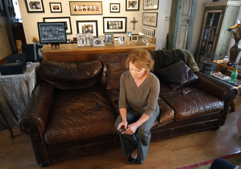 Photo - Melinda Coleman listens to audio recordings during an interview in her home in Albany, Mo., Wednesday, Oct. 16, 2013. Coleman says justice was denied when charges were dropped against the boys that her 14-year-old daughter said sexually assaulted her and a 13-year-old friend. (AP Photo/Orlin Wagner)