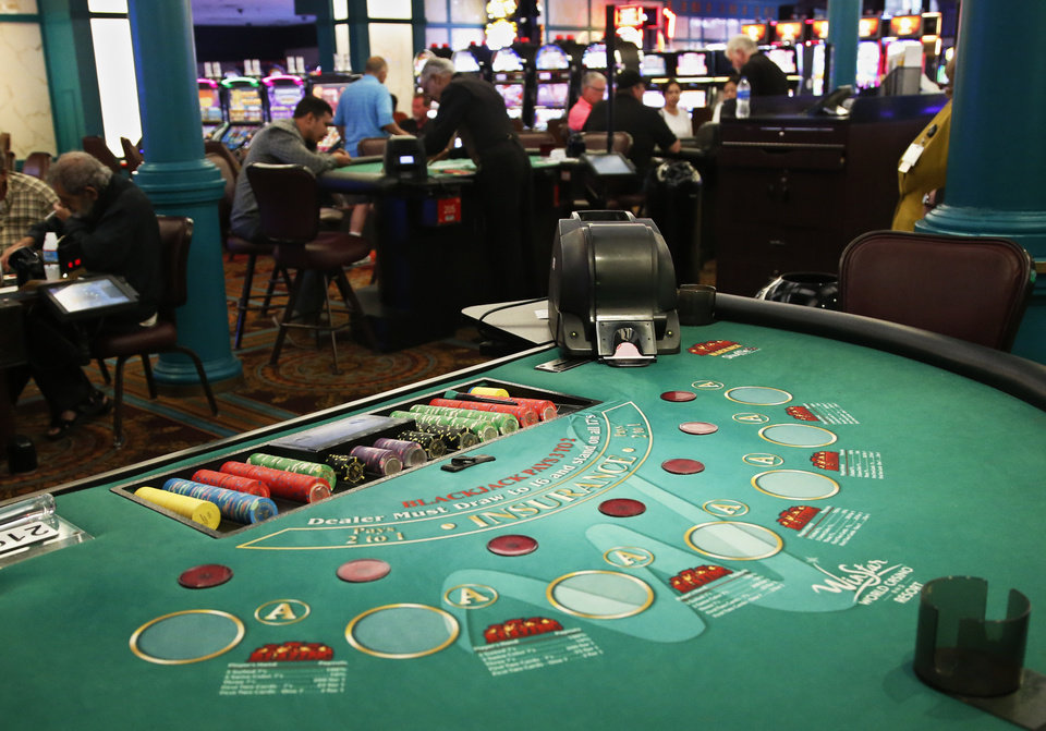Photo -  In the Tuesday, July 23, 2019 photo, a black jack table is pictured on the gaming floor at WinStar World Resort and Casino in Thackerville, Okla. [AP Photo/Sue Ogrocki]