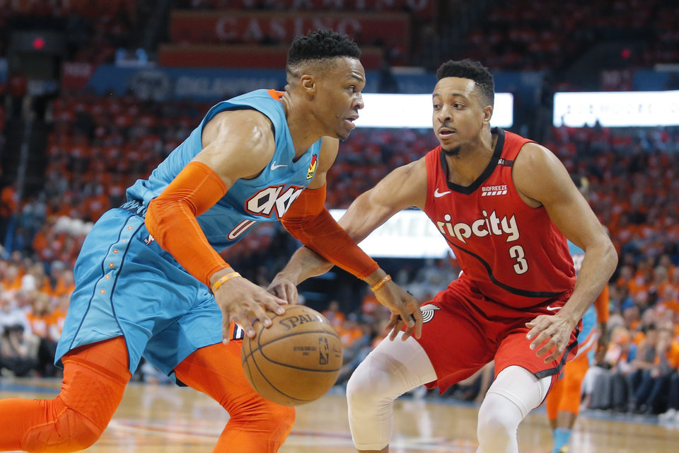 Photo - Oklahoma City's Russell Westbrook (0) goes past Portland's CJ McCollum (3) during Game 3 in the first round of the NBA playoffs between the Portland Trail Blazers and the Oklahoma City Thunder at Chesapeake Energy Arena in Oklahoma City, Friday, April 19, 2019. Photo by Bryan Terry, The Oklahoman