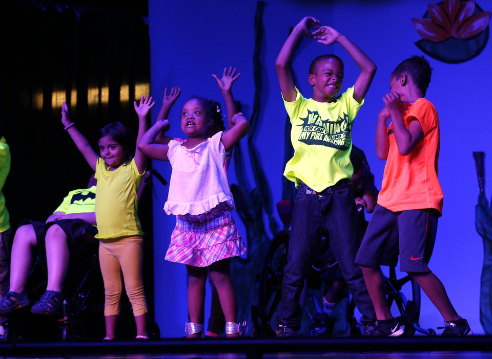 Photo - Children perform during a musical show at Special Care in Oklahoma City, Thursday, July 24, 2014. Photo by Sarah Phipps, The Oklahoman