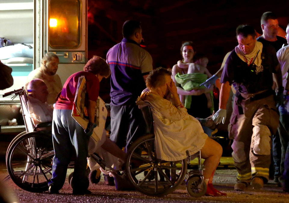 Photo - Emergency workers evacuate elderly from a damaged nursing home following an explosion at a fertilizer plant Wednesday, April 17, 2013, in West, Texas. An explosion at a fertilizer plant near Waco caused numerous injuries and sent flames shooting high into the night sky on Wednesday. (AP Photo/ Waco Tribune Herald, Rod Aydelotte)