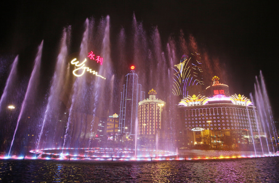 Photo - In this April 22, 2010 photo, Music fountain performs at the Wynn Macau. Macau is in the midst of one of the greatest gambling booms the world has ever known. To rival it, Las Vegas would have to attract six times as many visitors essentially every man, woman and child in America. Wynn Las Vegas now makes nearly three-quarters of its profits in Macau. Sands, which owns the Venetian and Palazzo, earns two-thirds of its revenue there. (AP Photo/Kin Cheung)