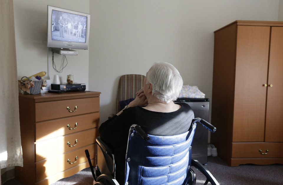 "In this Tuesday, Jan. 8, 2013 photo, an elderly woman who has suffered abuse by a relative watches ""I Love Lucy"" on a television inside her room at Cedar Village retirement community, in Mason, Ohio. The Shalom Center that is a part of the community helps the woman by offering shelter, along with medical, psychological and legal help, to elderly abuse victims in this northern Cincinnati suburb. The center asked that her identity be protected for this story because the close relatives who allegedly abused her don't know where she is. (AP Photo/Al Behrman)"