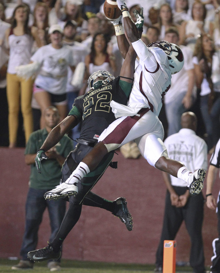 Photo -   Baylor defender Joe Williams, left, knocks away a pass intended for Louisiana-Monroe receiver Tavarese Maye during the first half of an NCAA college football game, Friday, Sept. 21, 2012, in Monroe, La. (AP Photo/Waco Tribune Herald, Duane A. Laverty)