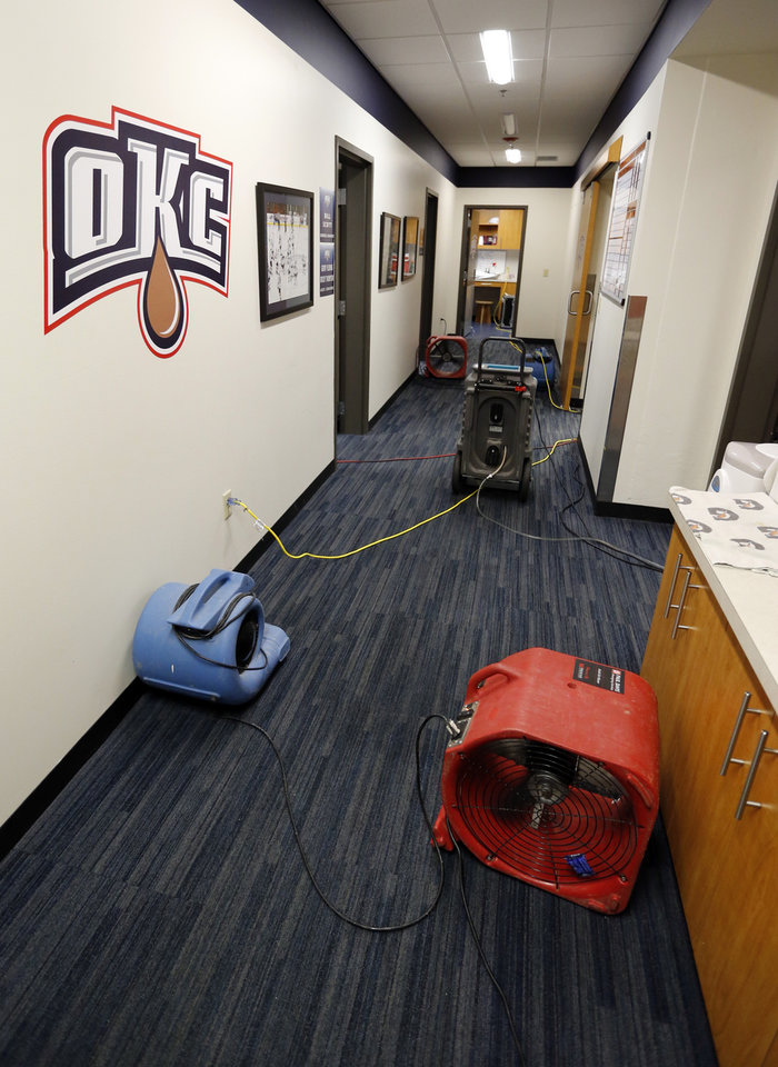 Photo - Fans blow dry the Baron's locker room at the Cox Convention Center where leaks occurred after Friday night's storm on Saturday, June 1, 2013 in Oklahoma City, Okla.  Photo by Steve Sisney, The Oklahoman