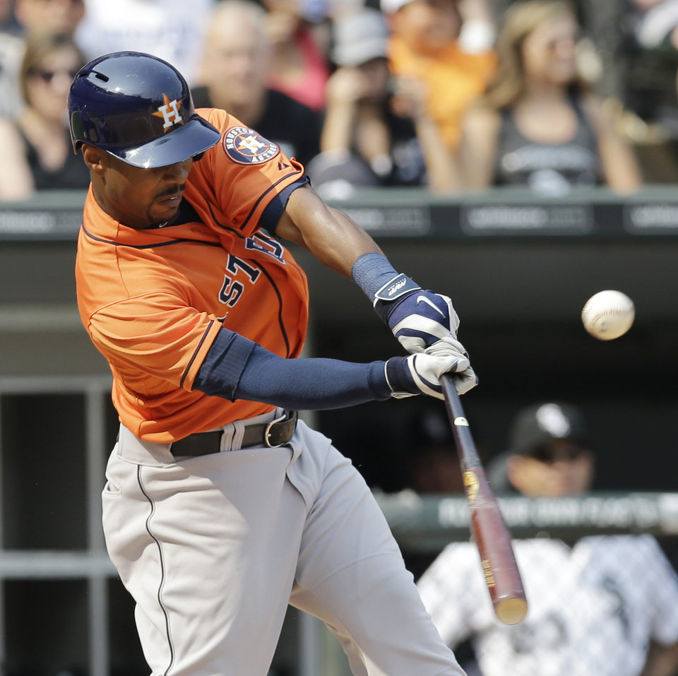 Photo - Houston Astros' L.J. Hoes hits an one-run double against the Chicago White Sox during the seventh inning of a baseball game in Chicago on Sunday, July 20, 2014. (AP Photo/Nam Y. Huh)