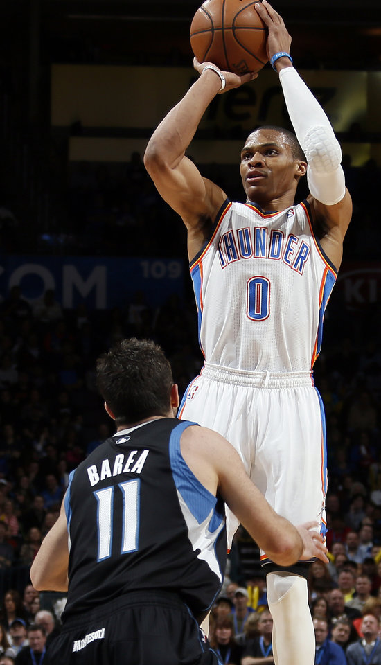 Photo - Oklahoma City's Russell Westbrook (0) shoots over Minnesota's J.J. Barea (11) during an NBA basketball game between the Oklahoma City Thunder and Minnesota Timberwolves at Chesapeake Energy Arena in Oklahoma City, Friday, Feb. 22, 2013. Photo by Nate Billings, The Oklahoman
