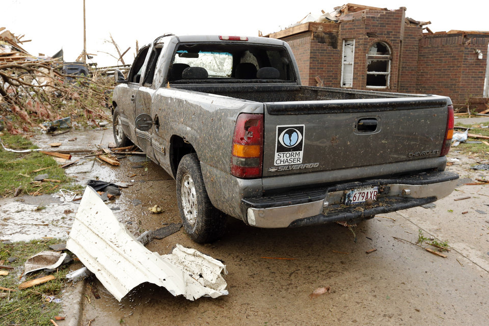 A pickup with a Storm Chaser decal was damaged by a tornado near SW 149th and Western on Monday, May 20, 2013  in Moore, Okla. Photo by Steve Sisney, The Oklahoman