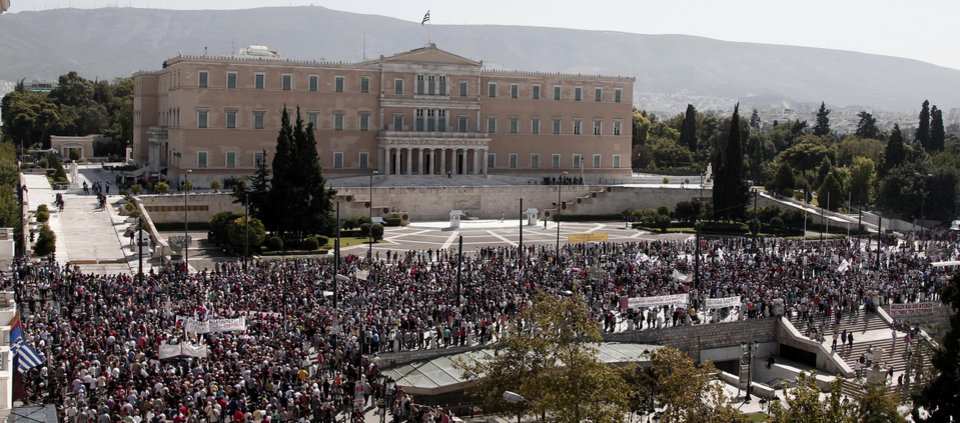 Photo -   Protesters of the Greek Communist party affiliated unions march in front of the Greek Parliament in Athens Wednesday Sept. 26, 2012. Greek workers walked off the job Wednesday for the first general strike since the country's coalition government was formed in June, as the prime minister and finance minister hammered out a package of euros 11.5 billion ($14.87 billion) in spending cuts. (AP Photo/Dimitri Messinis)