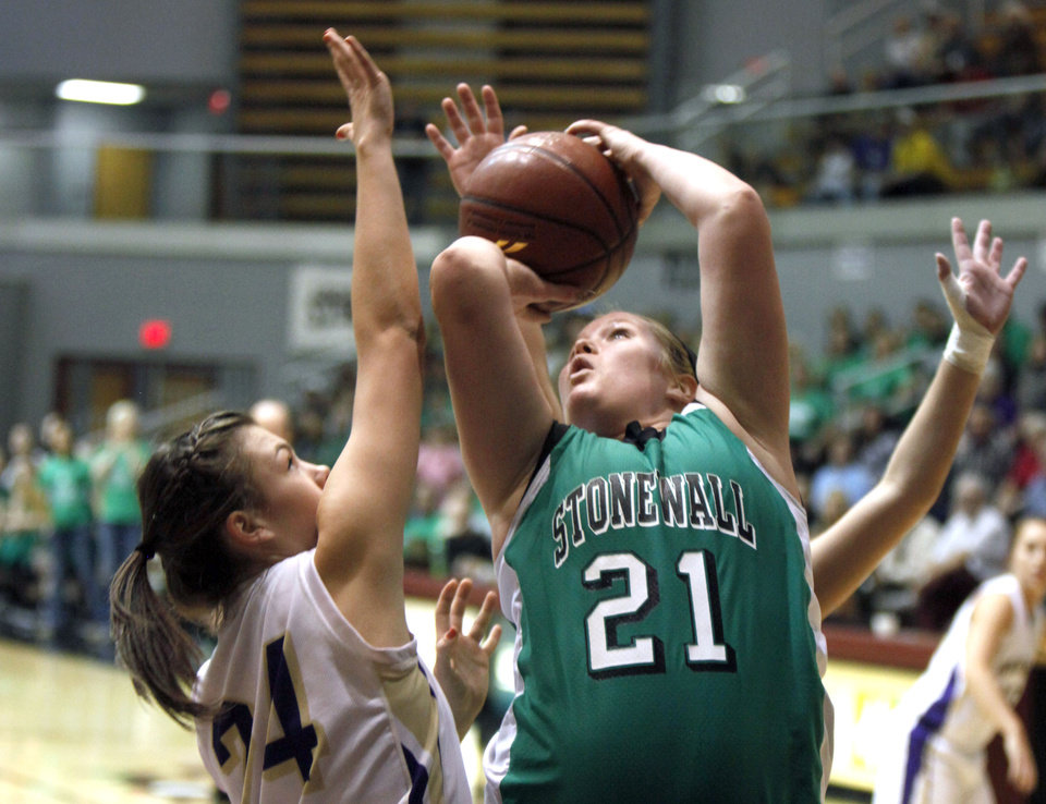 Photo - Stonewall's Breann Gipson shoots over Okarche's Madison Lee during the girl's class A basketball playoffs at Southern Nazarene University's Sawyer Center in Bethany, OK, Thursday, March 1, 2012. By Paul Hellstern, The Oklahoman