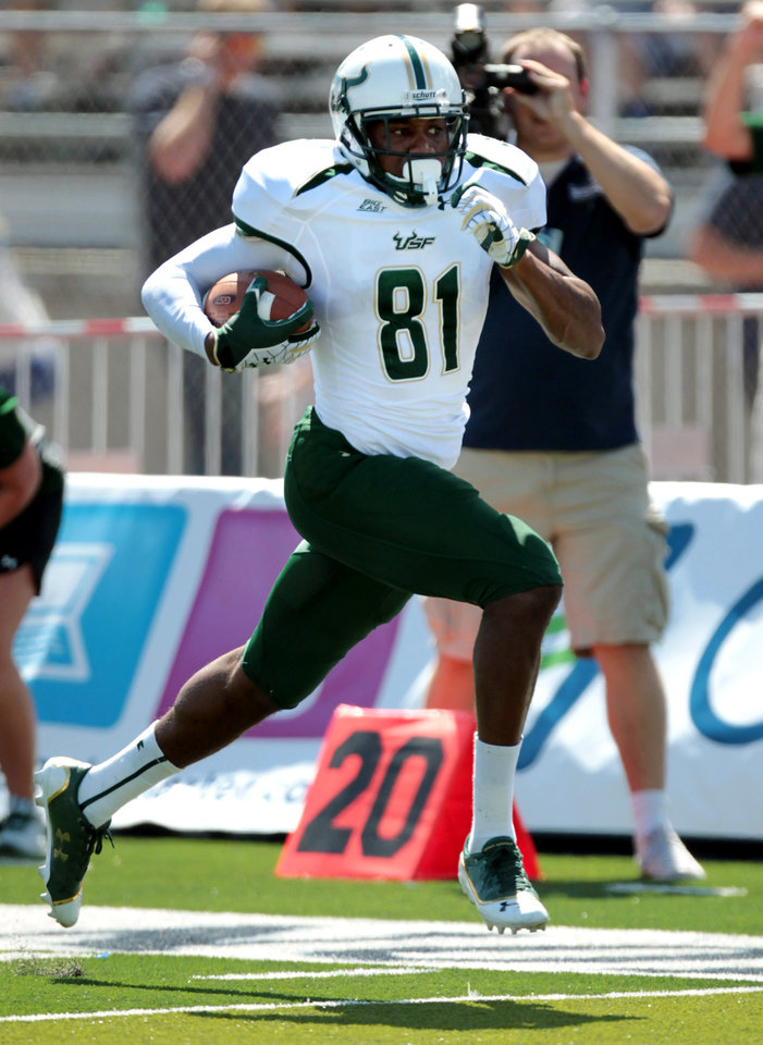 Photo -   South Florida's Andre Davis (81) scores on a 51-yard reception against Nevada during the first half of an NCAA college football game Saturday, Sept. 8, 2012, in Reno, Nev. (AP Photo/Cathleen Allison)