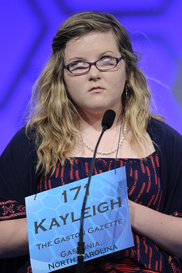 "Photo - Kayleigh Guffey, 13, of Gastonia, N.C.,  spells the word ""altruism"" during the 2015 Scripps National Spelling Bee in Oxon Hill, Md., Wednesday, May 27, 2015. (AP Photo/Cliff Owen)"