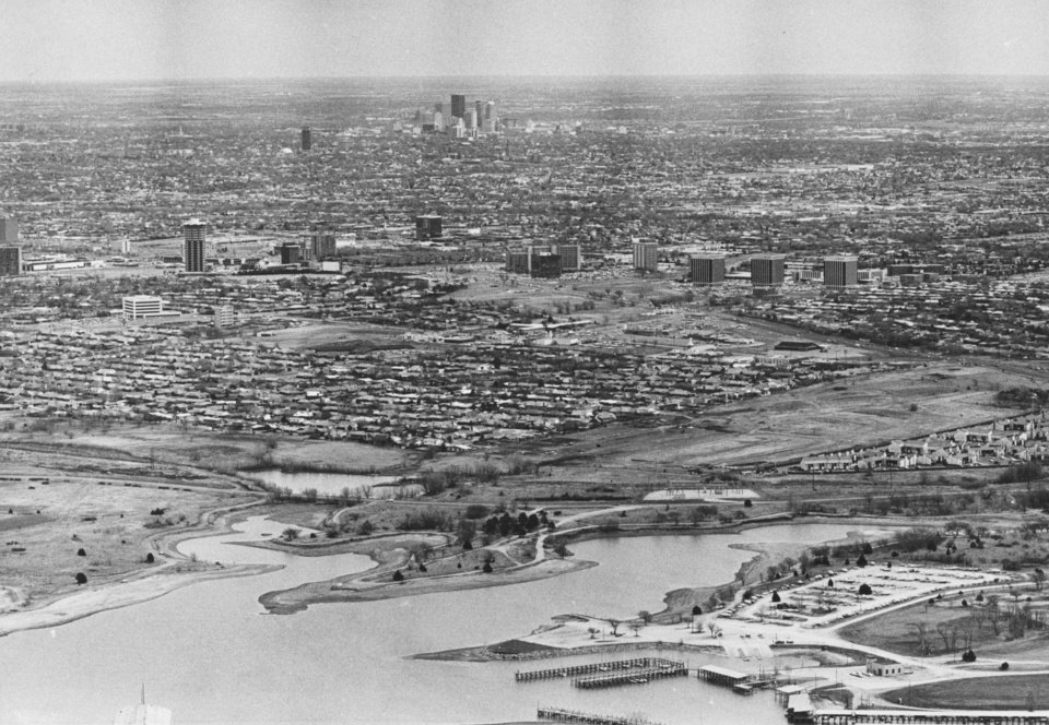 OKLAHOMA CITY / SKY LINE / OKLAHOMA / AERIAL VIEWS / AERIAL PHOTOGRAPHY / AIR VIEWS:  A different view of Oklahoma City is captured by photographer Al McLaughlin who shot this aerial photograph over Lake Hefner.  Part of the lake is visible in the foreground.  Other landmarks, including the United Founders Tower and Baptist Medical Center, can be spotted.  In the distance is the downtown skyline.  Staff photo by Al McLaughlin.  Photo dated 06/10/1980 and published on 06/01/1980 in The Daily Oklahoman.