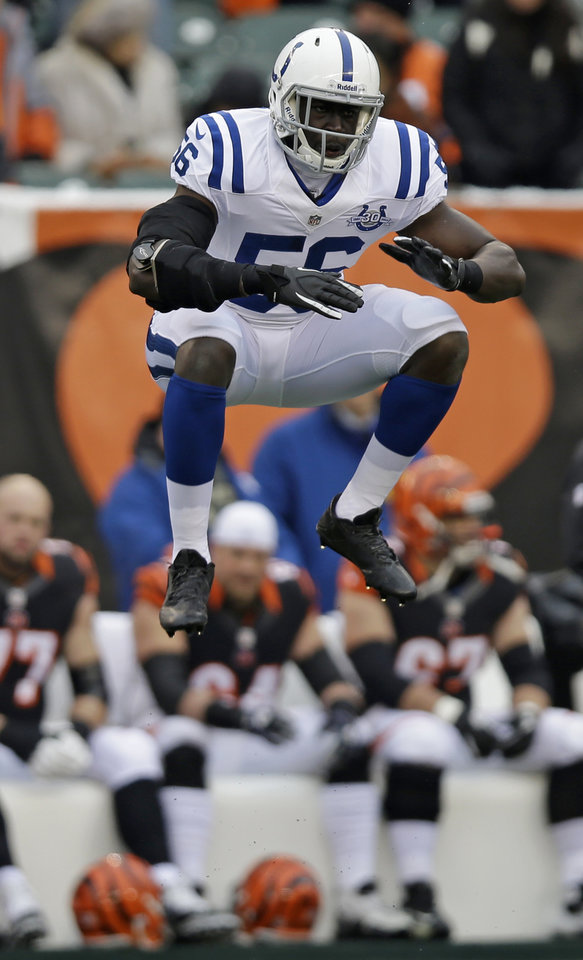 Photo - Indianapolis Colts linebacker Daniel Adongo jumps in the air just prior to receiving a kickoff in the first half of an NFL football game against the Cincinnati Bengals, Sunday, Dec. 8, 2013, in Cincinnati. Adongo is a rugby player from South Africa playing in his first football game. (AP Photo/Al Behrman)