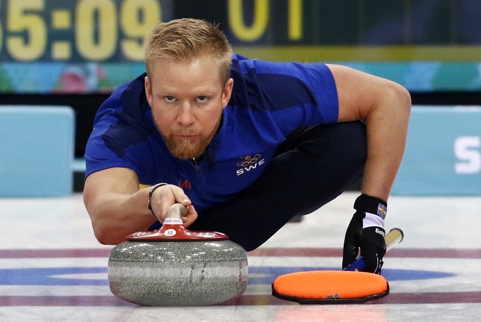 Photo - Sweden's skip Niklas Edin delivers the rock during the men's curling semifinal game against Britain at the 2014 Winter Olympics, Wednesday, Feb. 19, 2014, in Sochi, Russia. (AP Photo/Robert F. Bukaty)