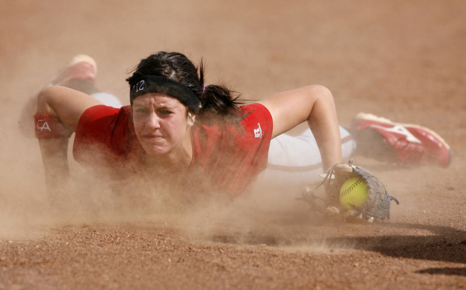 Carl Albert's Madisyn Long makes a diving catch during the Class 5A fast-pitch softball championship game between Carl Albert and McAlester at ASA Hall of Fame Stadium, Saturday, Oct. 16, 2010, in Oklahoma City. Photo by Sarah Phipps, The Oklahoman ORG XMIT: KOD
