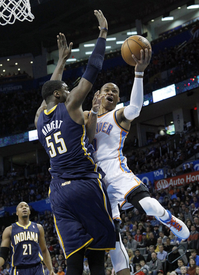Oklahoma City Thunder guard Russell Westbrook (0) shoots in front of Indiana Pacers center Roy Hibbert (55) in the first quarter of an NBA basketball game in Oklahoma City, Sunday, Dec. 9, 2012. (AP Photo/Sue Ogrocki)