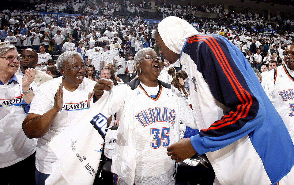 Photo - THE SON :  Shown here celebrating with his grandmother following the Thunder's Game 4 victory of their first-round NBA Playoff series with the Lakers, Kevin Durant has made his family a part of everything. His father, Wayne Pratt, and his brothers work his basketball camp. His mother, Wanda Pratt, is a regular at Thunder games. And he announced his contract extension on Thursday via Twitter by writing,