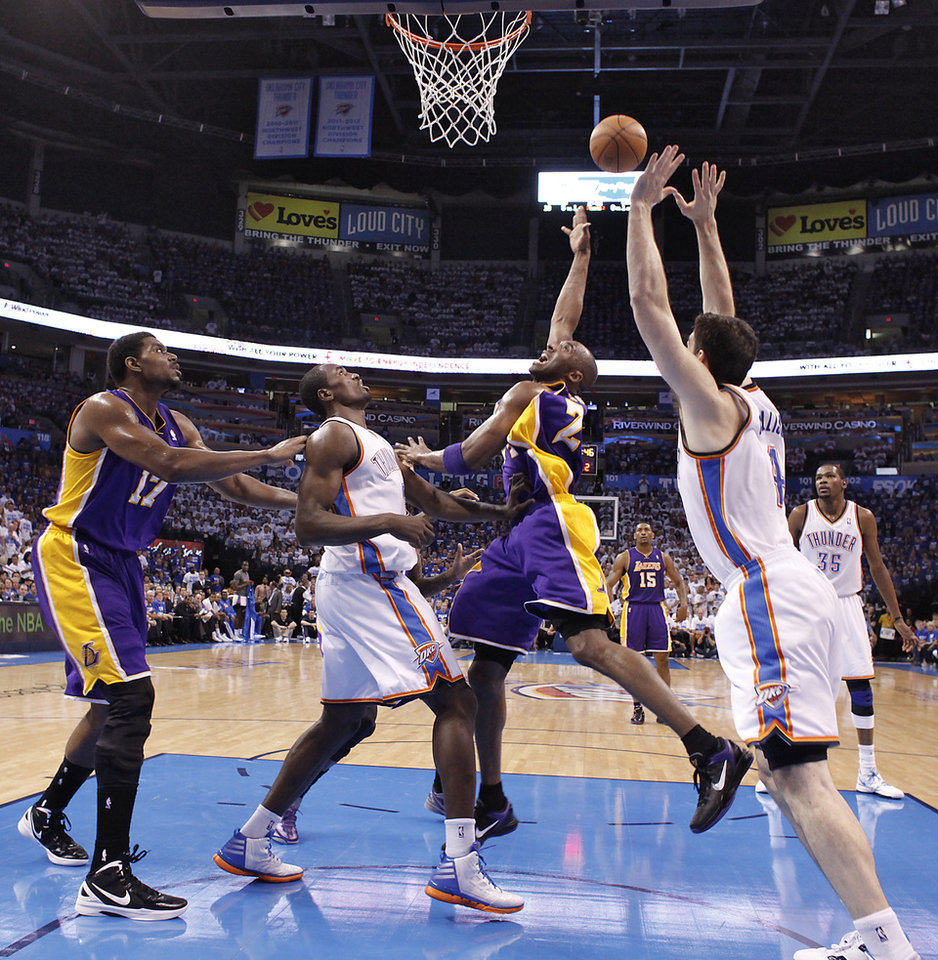 Los Angeles' Kobe Bryant puts up a shot over Oklahoma City's Serge Ibaka and Nick Collison during Game 2 in the second round of the NBA playoffs between the Oklahoma City Thunder and the L.A. Lakers at Chesapeake Energy Arena on Wednesday,  May 16, 2012,in Oklahoma City, Oklahoma. Photo by Chris Landsberger, The Oklahoman