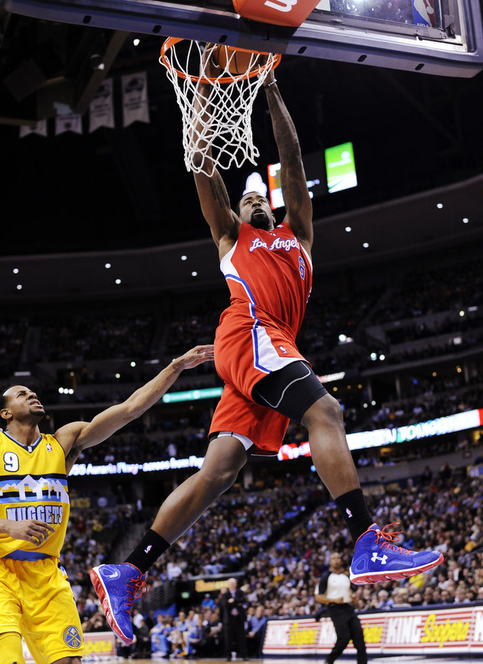 Photo - Los Angeles Clippers center DeAndre Jordan (6) dunks against Denver Nuggets guard Andre Iguodala (9) during the second quarter of an NBA basketball game, Tuesday, Jan. 1, 2013, in Denver. (AP Photo/Jack Dempsey)