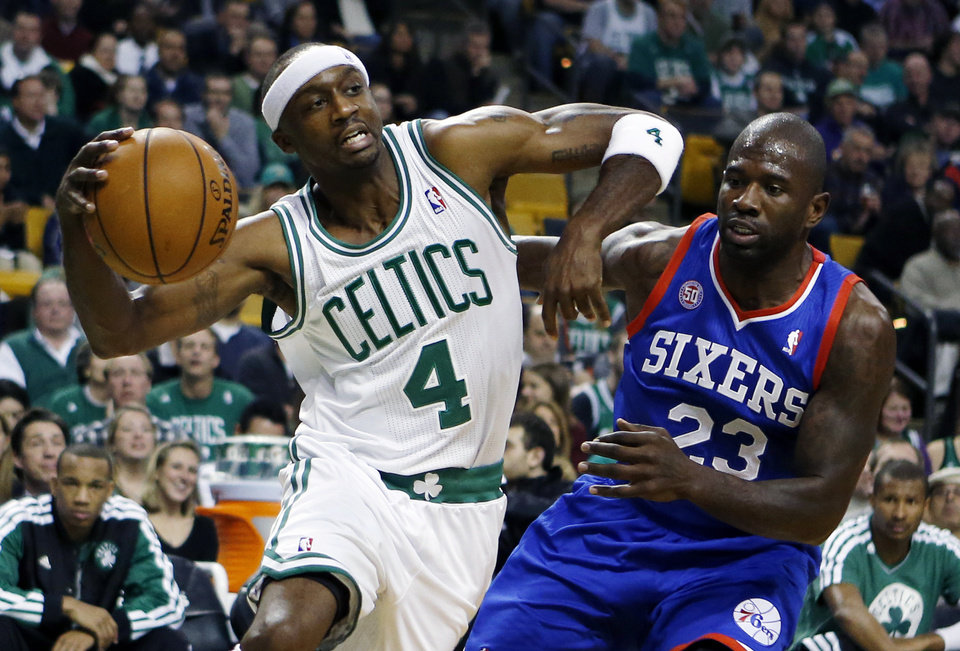 Boston Celtics' Jason Terry (4) drives past Philadelphia 76ers' Jason Richardson (23) in the first quarter of an NBA basketball game in Boston, Saturday, Dec. 8, 2012. (AP Photo/Michael Dwyer)