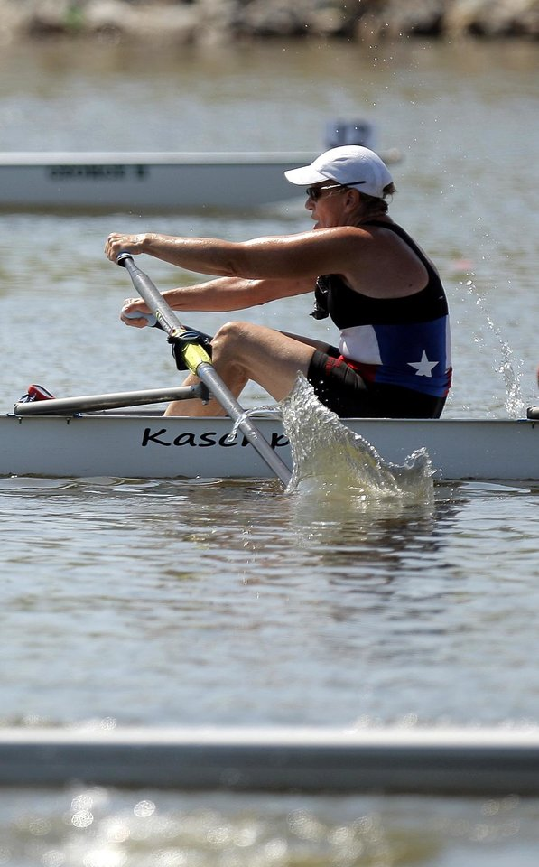 A members of Texas Rowing competes in the Womens' Open 3 4x during the USRowing Masters National Championships on the Oklahoma River, Sunday, Aug. 14, 2011. Photo by Sarah Phipps, The Oklahoman